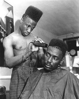 """Big Daddy Kane"" getting his ""Fade"" haircut all trimmed up. (Image courtesy of Fashion Bomb Daily)."