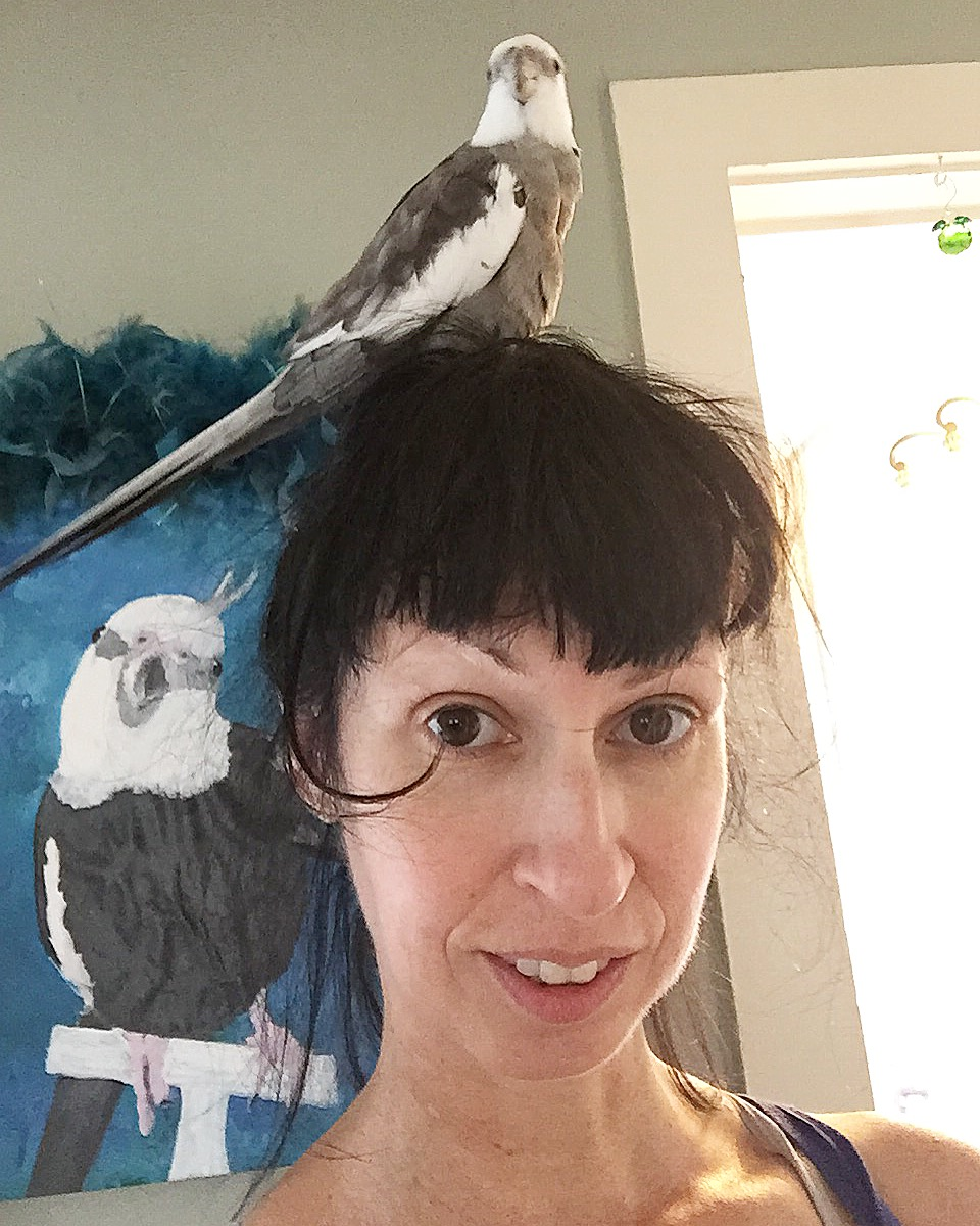 Happiness is....when your mommy thinks your feathers are so pretty she asks to borrow them to complement her outfit!